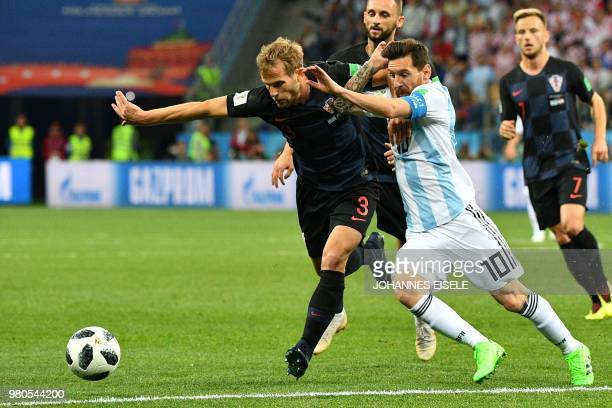 TOPSHOT Croatia's defender Ivan Strinic vies with Argentina's forward Lionel Messi during the Russia 2018 World Cup Group D football match between...