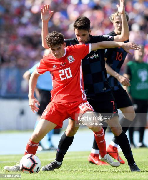 Croatia's defender Josip Brekalo vies with Wales midfielder Daniel James during the Euro 2020 qualification football match between Croatia and Wales...