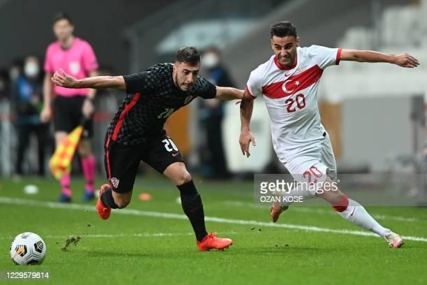 Croatia's defender Josip Juranovic challenges Turkey's midfielder Deniz Turuc during the friendly football match between Turkey and Croatia at the...