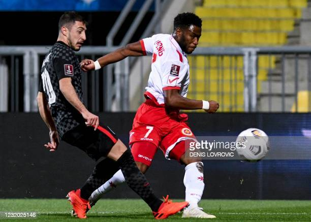 Croatia's defender Josip Juranovic fights for the ball with Malta's midfielder Joseph Mbong during the FIFA World Cup Qatar 2022 qualification Group...