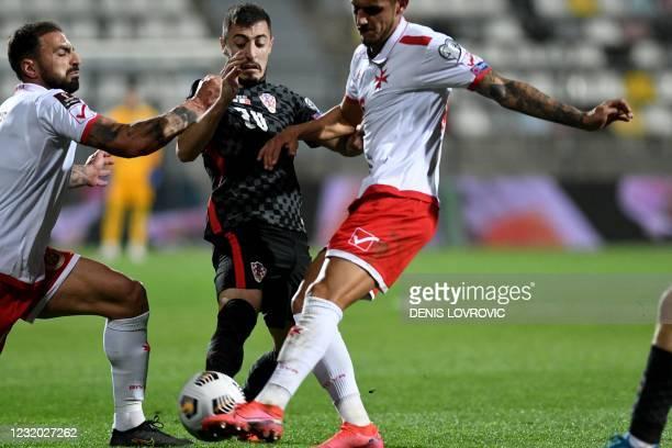 Croatia's defender Josip Juranovic is challenged by Malta's defender Steve Borg and Malta's forward Steve Pisani during the FIFA World Cup Qatar 2022...
