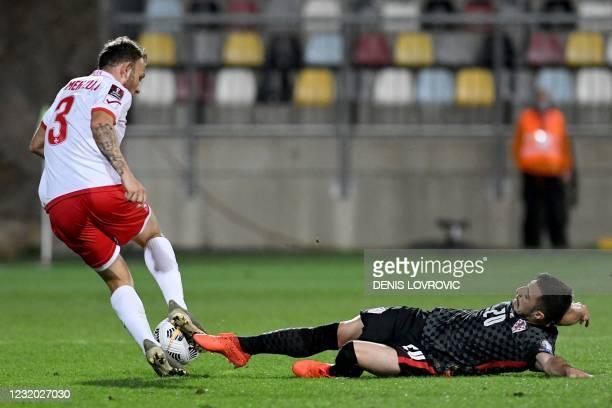 Croatia's defender Josip Juranovic is challenged by Malta's midfielder Ryan Camenzuli during the FIFA World Cup Qatar 2022 qualification Group H...