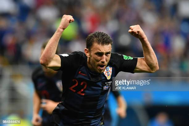 TOPSHOT Croatia's defender Josip Pivaric celebrates after a goal during the Russia 2018 World Cup Group D football match between Iceland and Croatia...