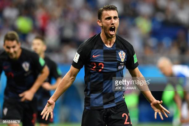 Croatia's defender Josip Pivaric celebrates after a goal during the Russia 2018 World Cup Group D football match between Iceland and Croatia at the...