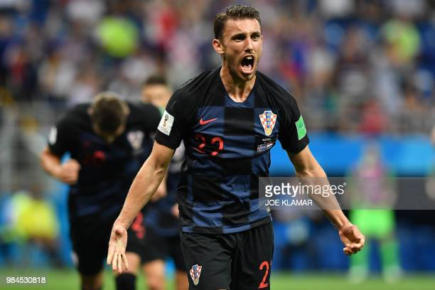 TOPSHOT Croatia's defender Josip Pivaric celebrates after his team's opening goal during the Russia 2018 World Cup Group D football match between...
