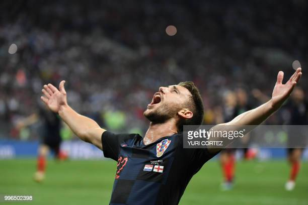 TOPSHOT Croatia's defender Josip Pivaric celebrates at the end of the Russia 2018 World Cup semifinal football match between Croatia and England at...