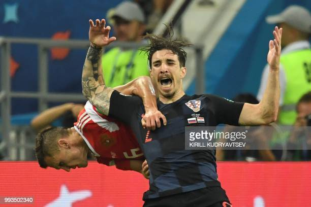 TOPSHOT Croatia's defender Sime Vrsaljko and Russia's midfielder Denis Cheryshev vie for the ball during the Russia 2018 World Cup quarterfinal...