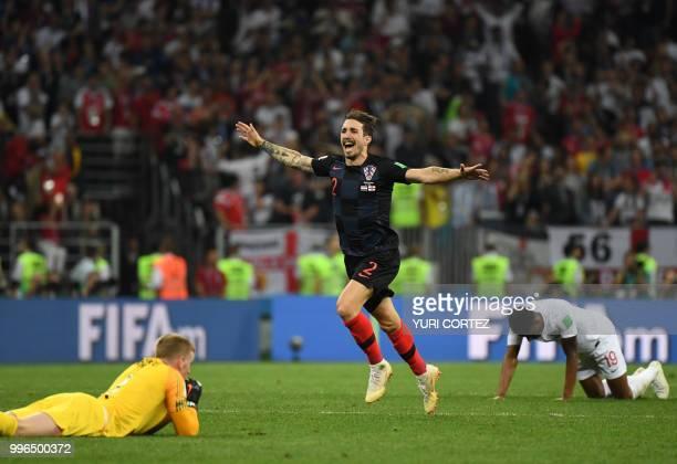 Croatia's defender Sime Vrsaljko celebrates past England's goalkeeper Jordan Pickford and England's forward Marcus Rashford at the end of the Russia...