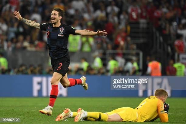 TOPSHOT Croatia's defender Sime Vrsaljko celebrates past England's goalkeeper Jordan Pickford at the end of the Russia 2018 World Cup semifinal...