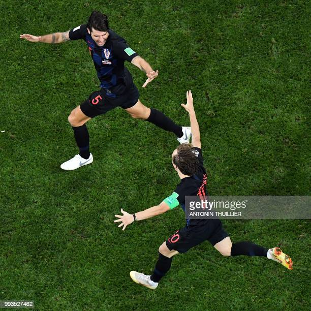 Croatia's defender Vedran Corluka and Croatia's midfielder Luka Modric celebrate at the end of the penalty shootouts of the Russia 2018 World Cup...