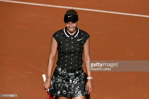 Croatia's Donna Vekic celebrates after winning against Switzerland's Belinda Bencic during their women's singles third round match on day six of The...