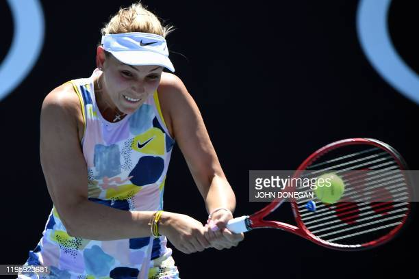 Croatia's Donna Vekic hits a return against Poland's Iga Swiatek during their women's singles match on day six of the Australian Open tennis...