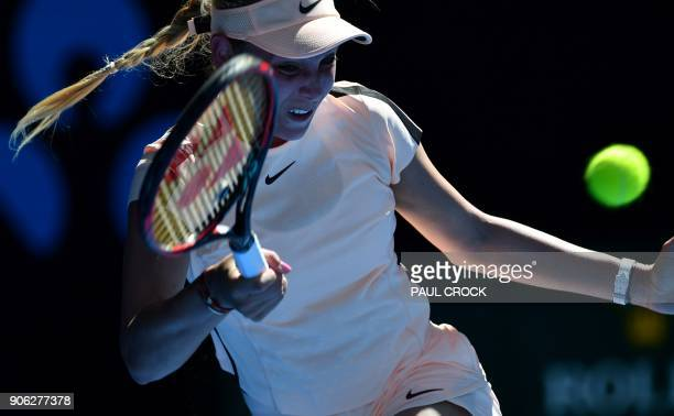 Croatia's Donna Vekic hits a return during their women's singles second round match against Germany's Angelique Kerber on day four of the Australian...