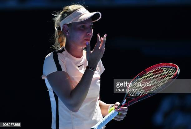 Croatia's Donna Vekic reacts during their women's singles second round match against Germany's Angelique Kerber on day four of the Australian Open...