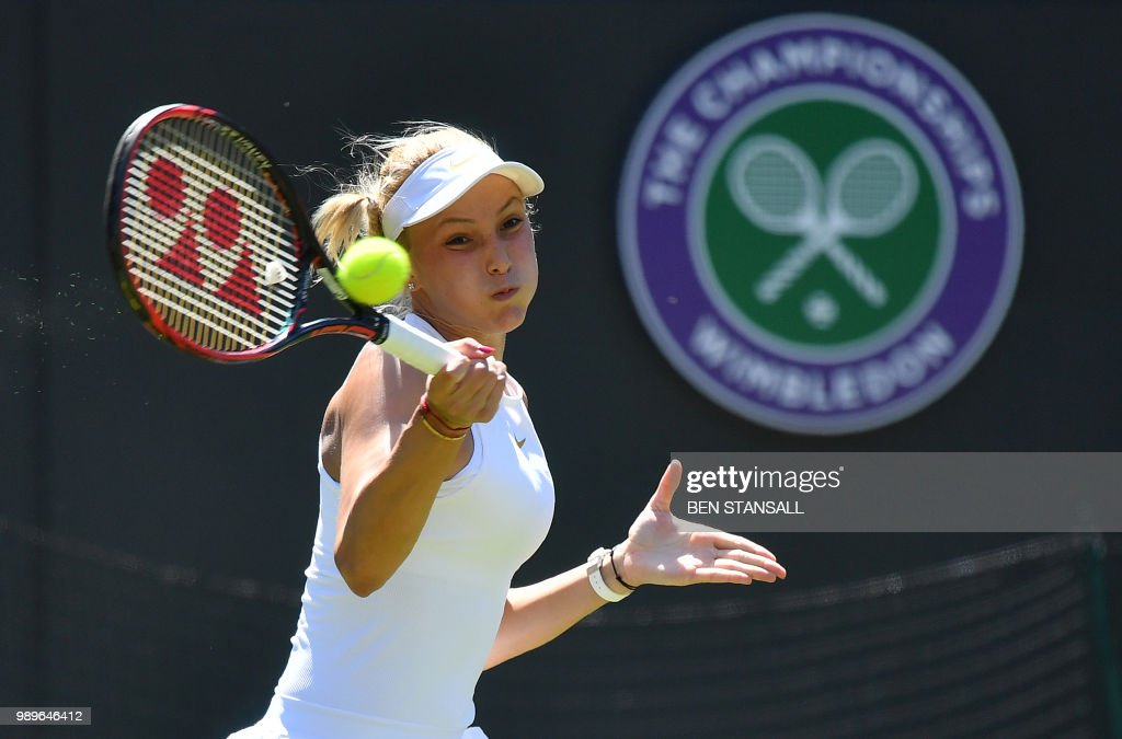 Croatia's Donna Vekic returns against US player Sloane Stephens during their women's singles first round match on the first day of the 2018 Wimbledon Championships at The All England Lawn Tennis Club in Wimbledon, southwest London, on July 2, 2018. (Photo by Ben STANSALL / AFP) / RESTRICTED