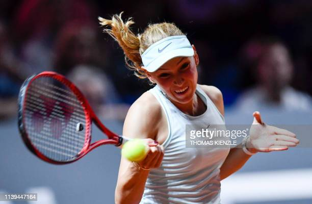Croatia's Donna Vekic returns the ball to Japan's Naomi Osaka during their quarterfinal match at the WTA Tennis Grand Prix in Stuttgart, southwestern...