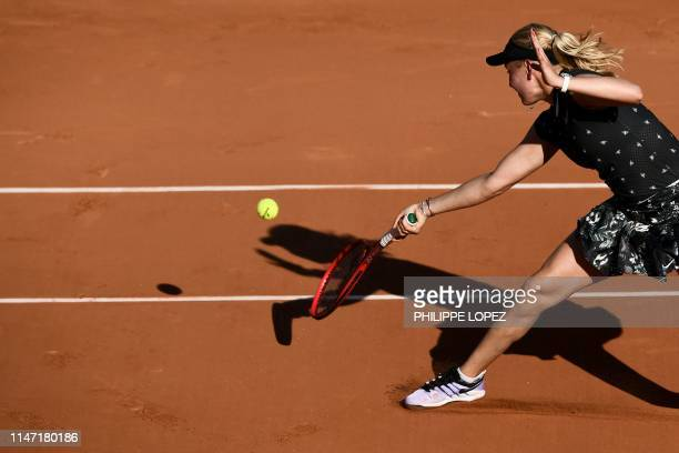 Croatia's Donna Vekic returns the ball to Switzerland's Belinda Bencic during their women's singles third round match on day six of The Roland Garros...