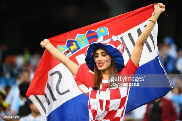 A Croatia's fan dispalys a national flag as she waits in the grandstand before the Russia 2018 World Cup Group D football match between Argentina and...