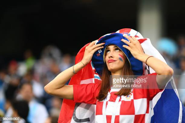 A Croatia's fan gestures as she waits in the grandstand before the Russia 2018 World Cup Group D football match between Argentina and Croatia at the...