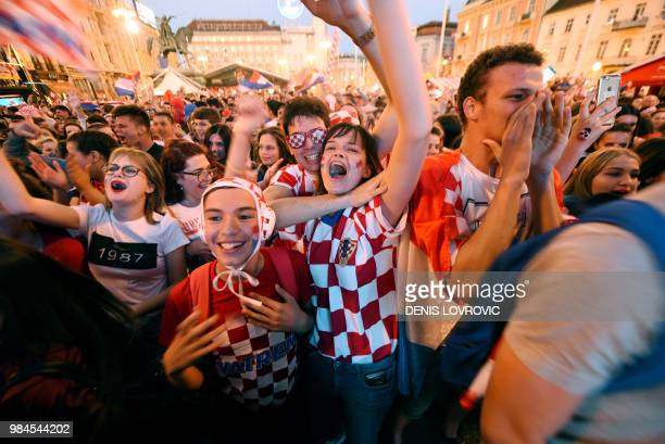 Croatia's fans celebrate a goal as they watch on a giant screen the Russia 2018 World Cup Group D football match between Iceland and Croatia in...
