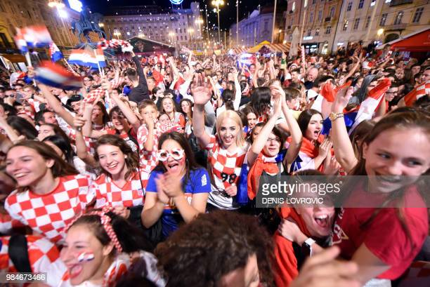 TOPSHOT Croatia's fans celebrate a goal as they watch on a giant screen the Russia 2018 World Cup Group D football match between Iceland and Croatia...