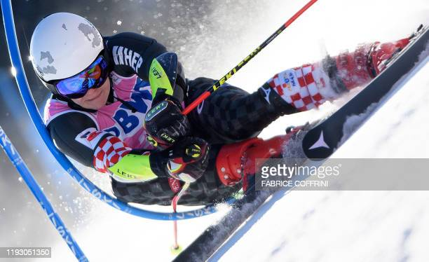 TOPSHOT Croatia's Filip Zubcic clears a gate during the first run of the Men's giant slalom race at the FIS Alpine Skiing World Cup on January 11...