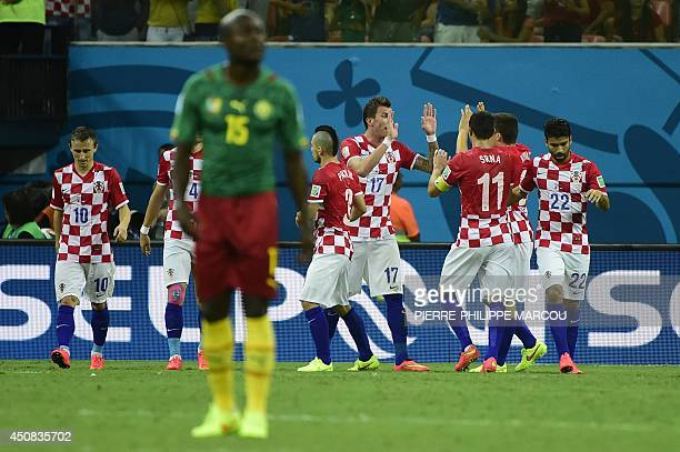 Croatia's footballers celebrate the second goal of forward Mario Mandzukic during a Group A football match between Cameroon and Croatia in the...