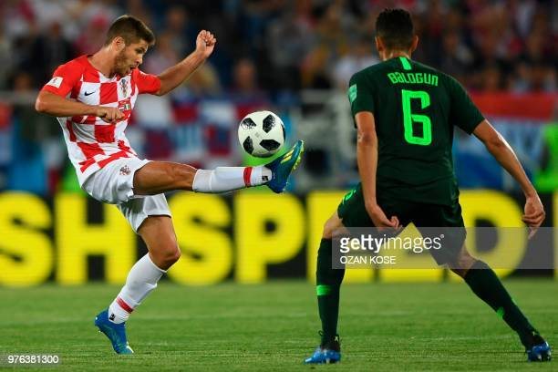 Croatia's forward Andrej Kramaric and Croatia's defender Dejan Lovren vie during the Russia 2018 World Cup Group D football match between Croatia and...