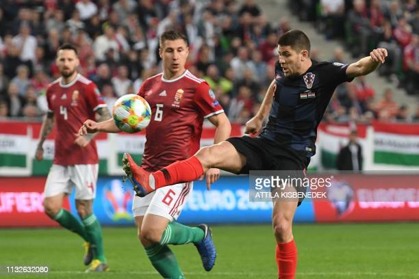 Croatia's forward Andrej Kramaric and Hungary's defender Willi Orban vie for the ball during the UEFA Euro 2020 football 1st round Groupe E...