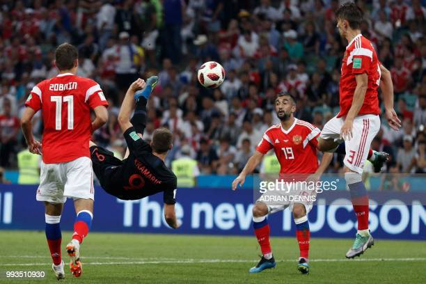 TOPSHOT Croatia's forward Andrej Kramaric attempts an overhead kick during the Russia 2018 World Cup quarterfinal football match between Russia and...