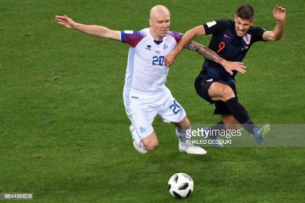 Croatia's forward Andrej Kramaric challenges Iceland's midfielder Emil Hallfredsson during the Russia 2018 World Cup Group D football match between...