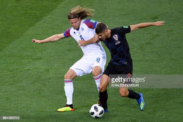 Croatia's forward Andrej Kramaric challenges Iceland's midfielder Birkir Bjarnason during the Russia 2018 World Cup Group D football match between...