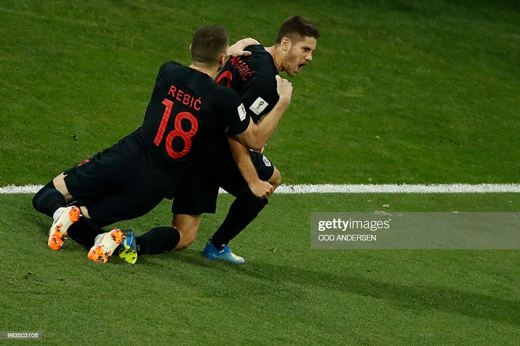 TOPSHOT - Croatia's forward Andrej Kramaric (C) is congratulated by Croatia's forward Ante Rebic after scoring the equalizer during the Russia 2018 World Cup quarter-final football match between Russia and Croatia at the Fisht Stadium in Sochi on July 7, 2018. (Photo by Odd ANDERSEN / AFP) / RESTRICTED