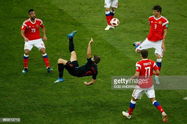 TOPSHOT Croatia's forward Andrej Kramaric kicks the ball during the Russia 2018 World Cup quarterfinal football match between Russia and Croatia at...