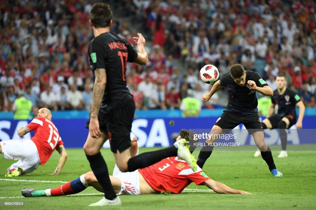 Croatia's forward Andrej Kramaric scores a header during the Russia 2018 World Cup quarter-final football match between Russia and Croatia at the Fisht Stadium in Sochi on July 7, 2018. (Photo by Kirill KUDRYAVTSEV / AFP) / RESTRICTED