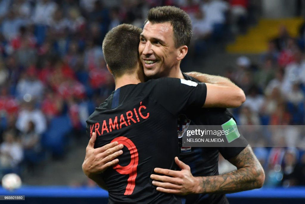 TOPSHOT - Croatia's forward Andrej Kramaric (L) thanks Croatia's forward Mario Mandzukic for the assist during the Russia 2018 World Cup quarter-final football match between Russia and Croatia at the Fisht Stadium in Sochi on July 7, 2018. (Photo by Nelson Almeida / AFP) / RESTRICTED