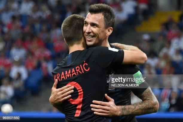 TOPSHOT Croatia's forward Andrej Kramaric thanks Croatia's forward Mario Mandzukic for the assist during the Russia 2018 World Cup quarterfinal...