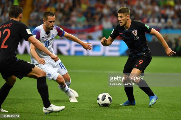 Croatia's forward Andrej Kramaric vies with Iceland's midfielder Gylfi Sigurdsson during the Russia 2018 World Cup Group D football match between...