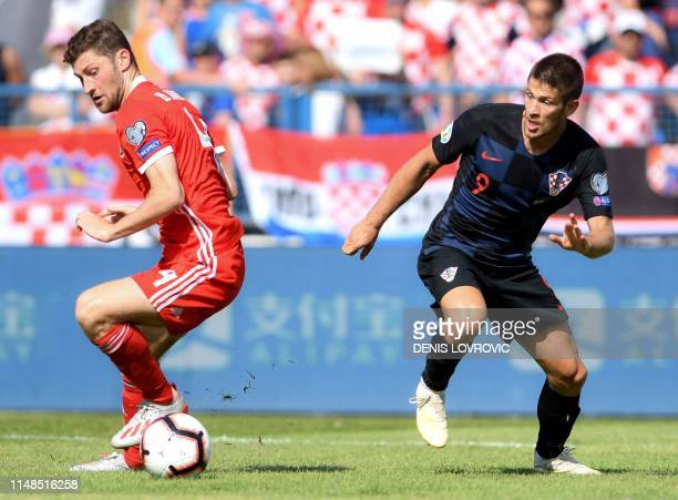 Croatia's forward Andrej Kramaric vies with Wales defender Ben Davies during the Euro 2020 qualification football match between Croatia and Wales at...