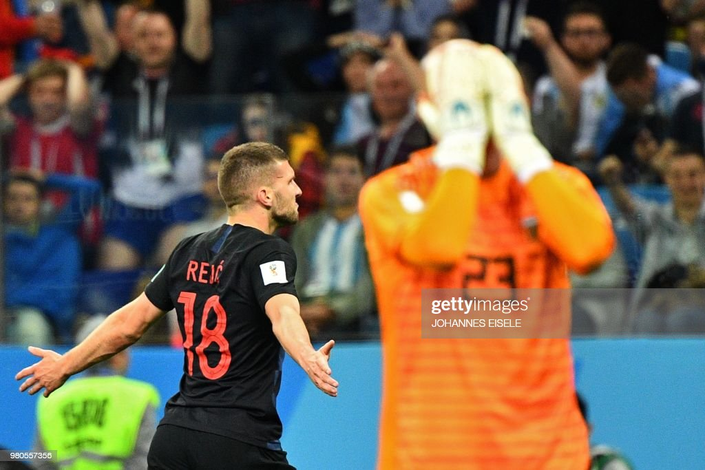 TOPSHOT - Croatia's forward Ante Rebic (L) celebrates after scoring their opener as Argentina's goalkeeper Willy Caballero reacts in foreground during the Russia 2018 World Cup Group D football match between Argentina and Croatia at the Nizhny Novgorod Stadium in Nizhny Novgorod on June 21, 2018. (Photo by Johannes EISELE / AFP) / RESTRICTED