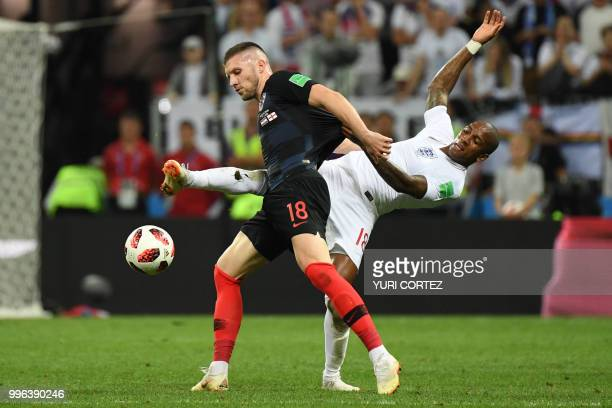 Croatia's forward Ante Rebic challenges England's defender Ashley Young during the Russia 2018 World Cup semi-final football match between Croatia...
