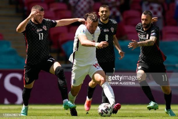 Croatia's forward Ante Rebic challenges England's midfielder Kalvin Phillips past Croatia's midfielder Marcelo Brozovic during the UEFA EURO 2020...