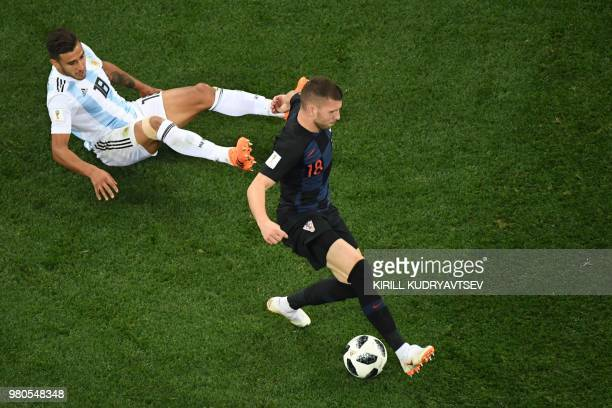 Croatia's forward Ante Rebic passes Argentina's midfielder Eduardo Salvio before to score during the Russia 2018 World Cup Group D football match...