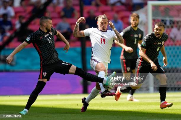 Croatia's forward Ante Rebic plays the ball past England's midfielder Kalvin Phillips during the UEFA EURO 2020 Group D football match between...