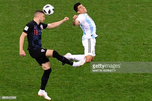 Croatia's forward Ante Rebic vies Argentina's defender Marcos Acuna during the Russia 2018 World Cup Group D football match between Argentina and...