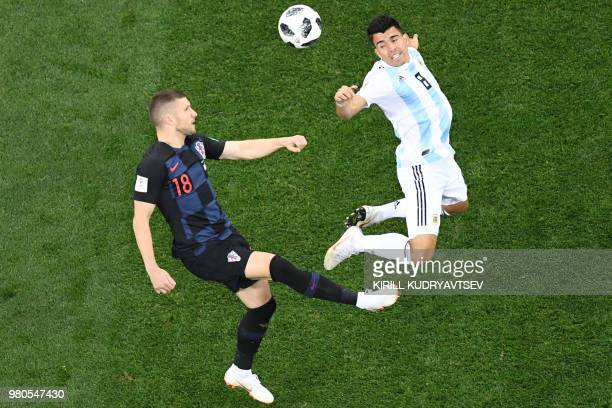 TOPSHOT Croatia's forward Ante Rebic vies Argentina's defender Marcos Acuna during the Russia 2018 World Cup Group D football match between Argentina...