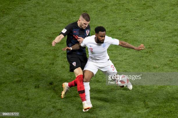 Croatia's forward Ante Rebic vies for the ball with England's defender Danny Rose during the Russia 2018 World Cup semifinal football match between...