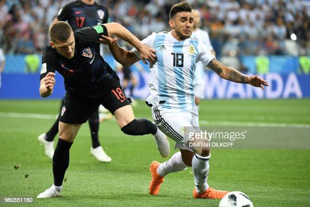 Croatia's forward Ante Rebic vies with Argentina's midfielder Eduardo Salvio during the Russia 2018 World Cup Group D football match between...