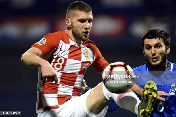 Croatia's forward Ante Rebic vies with Azerbaijan's midfielder Badavi Huseynov during the Euro 2020 qualification football match between Croatia and...