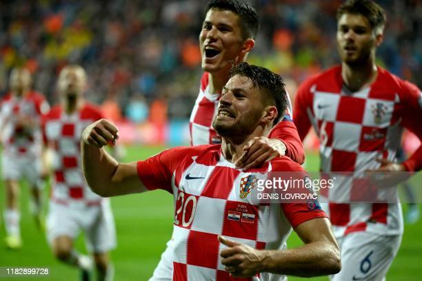 Croatia's forward Bruno Petkovic celebrates with teammates after scoring a goal during the Euro 2020 Group E football qualification match between...